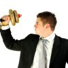 young businessman is trying with golden weight