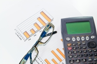 Calculator, Glasses And Graphs