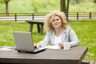 Business Lady Using Laptop In Park
