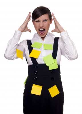 A girl with many post-it on her is Overwhelmed With Too Many Tasks