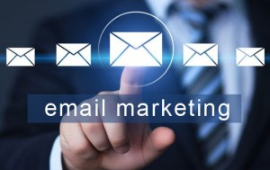 """email marketing"" words with hand pointing on envelope"