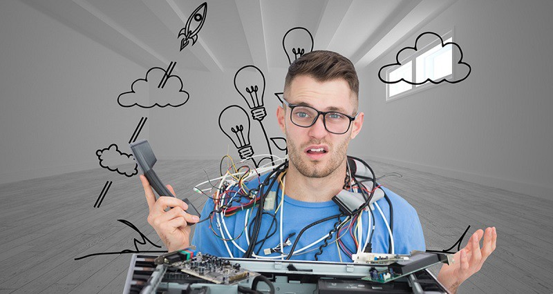 Composite image of confused young it professional with cables an